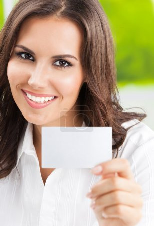 Businesswoman showing blank business card with copyspace