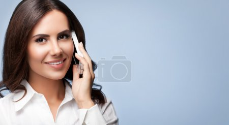 Cheerful customer support female phone operator with cell phone,