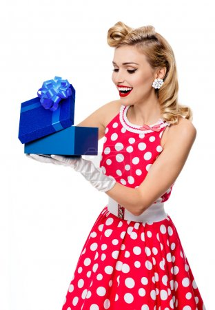 woman in pin-up style dress with gift box, isolated