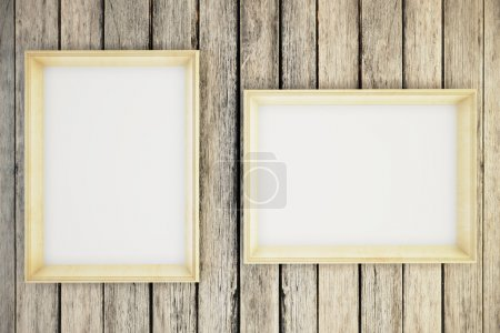 Two blank picture frames hanging on a wooden wall. Mock up, 3D Render