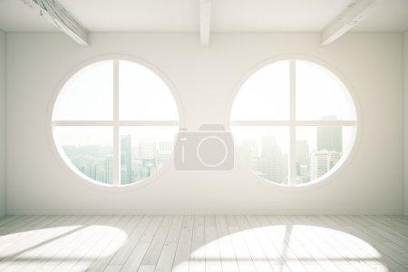 Photo pour Design d'intérieur ensoleillé avec plancher de bois et fenêtres rondes révélant la vue sur la ville. rendu 3D - image libre de droit