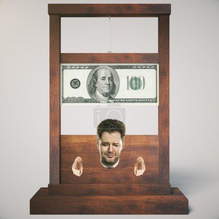 Photo pour Concept de dette avec l'homme sur le point de se faire couper la tête sur une guillotine en bois sombre, isolée sur fond clair. Rendu 3D - image libre de droit