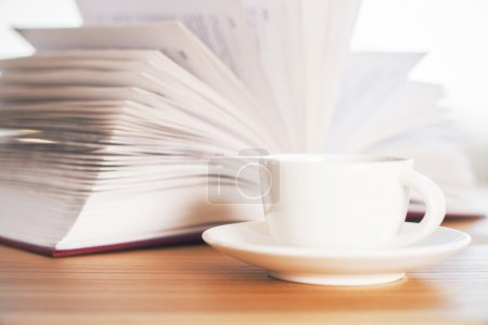 Book and ceramic coffee cup