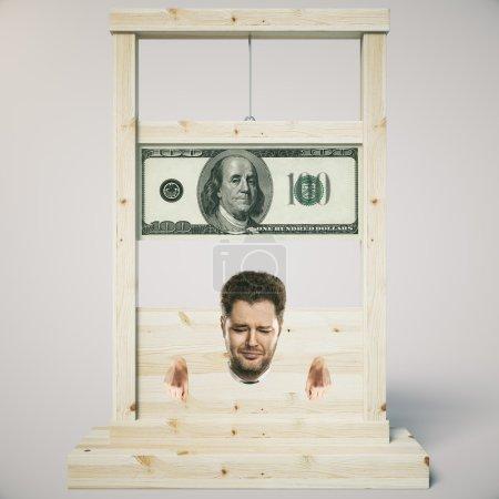Photo pour Concept de dette avec l'homme sur le point de se faire couper la tête sur une guillotine en bois léger, isolé sur fond blanc. Rendu 3D - image libre de droit