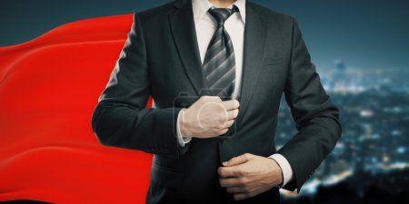 Businessman with red cape night