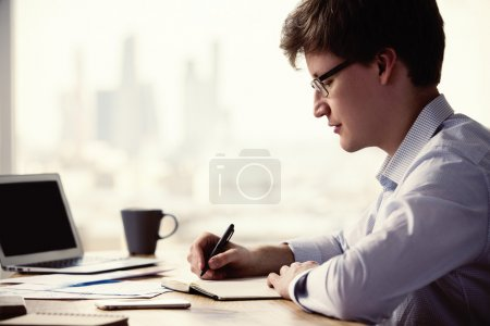 Businessman writing side