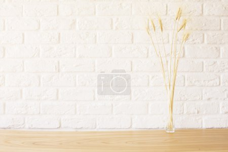 Wheat spikes on wooden desktop