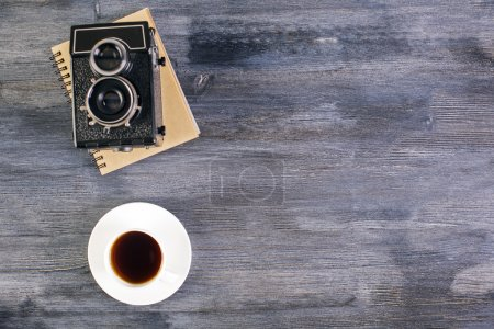 Desktop with coffee and camera