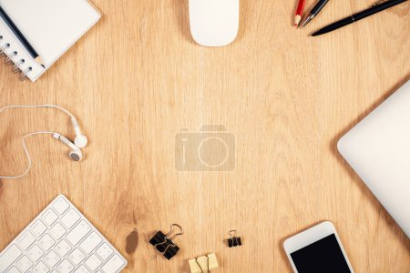 Desktop with stationery and technology