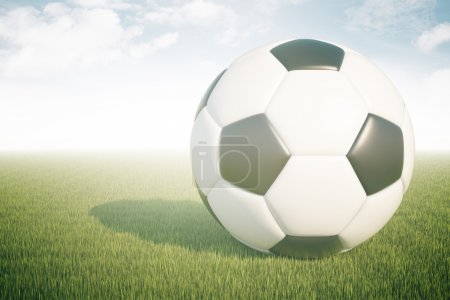 Closeup of football on green grass and sky background. 3D Rendering
