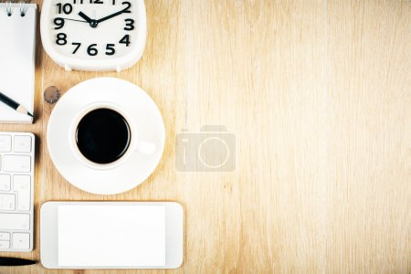 Desktop with coffee and phone