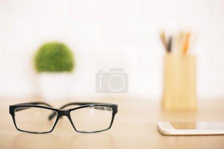 Glasses on desktop closeup