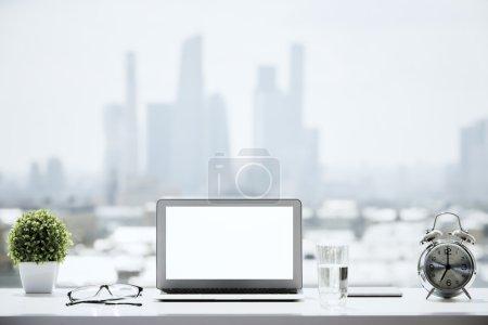 Windowsill with white laptop