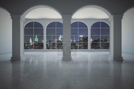 Photo pour Intérieur en béton classique avec colonnes et fenêtres panoramiques avec vue nocturne éclairée sur la ville. Rendu 3D - image libre de droit