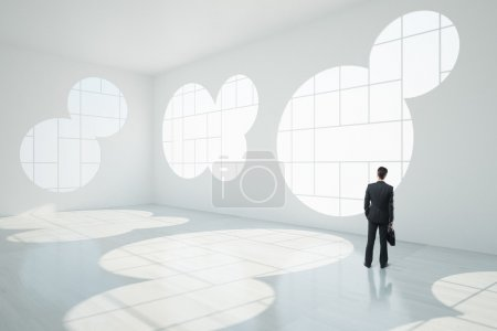 Businessman in abstract interior