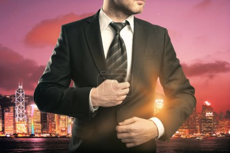 Businessman on red city background