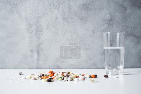 Water glass and pills