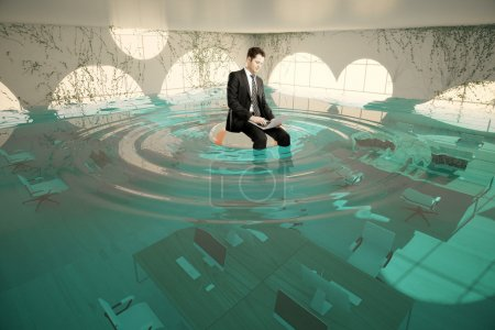 Businessman in flooded office