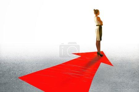 Businesswoman on arrow
