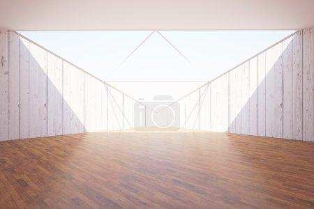 Foto de Interior abstracto con suelo de madera oscura, paredes de madera clara, techo abierto y luz solar. Renderizado 3D - Imagen libre de derechos