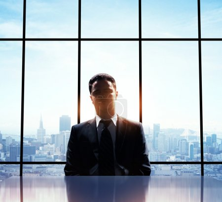 Photo for Young man standing alone in office - Royalty Free Image