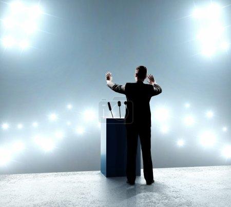 businessman standing on podium