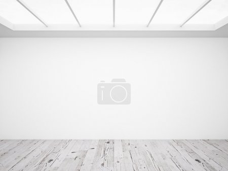 White concrete wall and wooden floor in loft