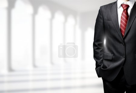 Photo for Businessman in suit standing in room - Royalty Free Image