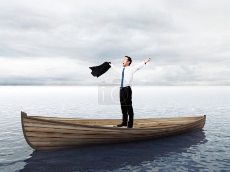 happy businessman standing on a boat