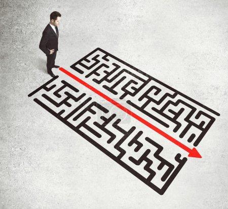 businessman looking on a labirinth