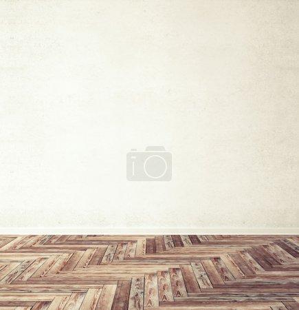 Foto de Parquet de espiga de madera marrón con pared - Imagen libre de derechos