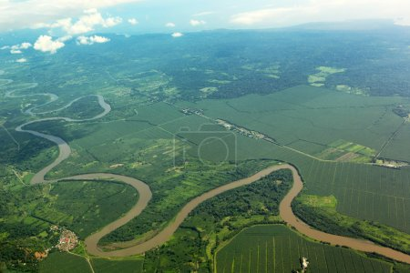 Meandering river viewed from the airplane in Costa...