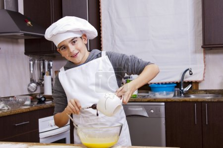 Photo for Child clothes chef making cakes - Royalty Free Image