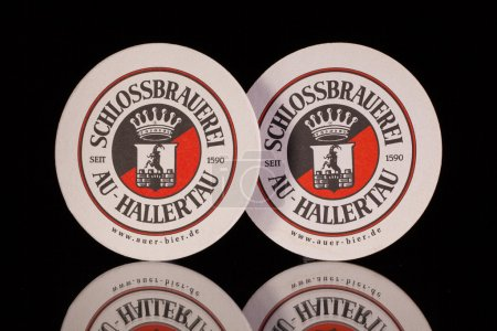 Photo pour Germany,Berlin -December 12,2014:Beermats from  Schlossbrauerei beer.For more than 400 years the brewery has been taking care that the local traditional beers are supplied regionally as well as internationally. - image libre de droit