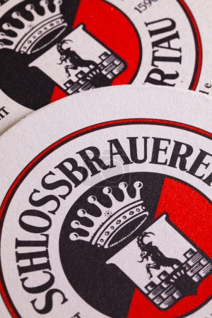 Photo pour Berlin,Germany-December 12,2014:Beermats from  Schlossbrauerei beer.For more than 400 years the brewery has been taking care that the local traditional beers are supplied regionally as well as internationally. - image libre de droit