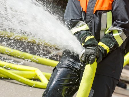 Fireman with a firehose