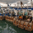 Rusty boats and metal nets for catching scallops...