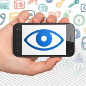 Protection concept: Hand Holding Smartphone with Eye on display