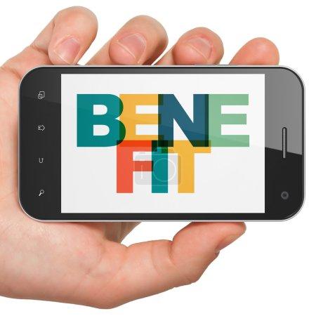 Photo pour Concept de finance : Smartphone à main avec texte multicolore peint Avantage à l'écran - image libre de droit