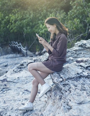 young beautiful woman connecting people by smart phone on sea si