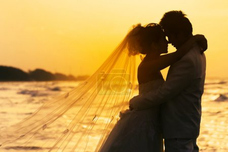 Photo for Groom and bride in love emotion romantic moment on the beach - Royalty Free Image
