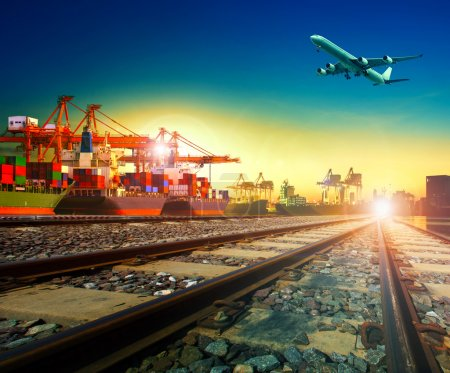 Photo for Railway transport in import export shipping port and cargo plane logistic flying above use as freight and transportation business service - Royalty Free Image