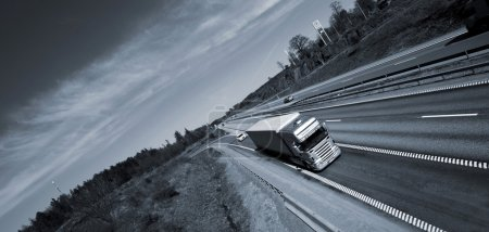 Truck driving on freeway, elevated view