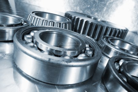 Titanium and steel ball-bearings and cogs