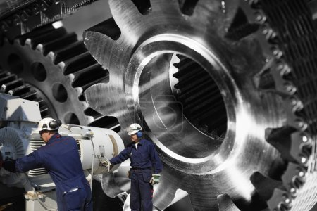 Photo for Workers, engineers with giant cogwheels and gears - Royalty Free Image