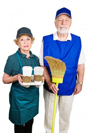 Foto de Senior couple working minimum wage jobs because they lost their retirement income.  Isolated on white. - Imagen libre de derechos