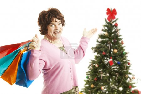 Photo for Man dressed as woman going on a Christmas shopping spree, holding bags.  Isolated on white. - Royalty Free Image