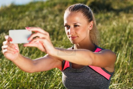 Young attractive woman making a selfie