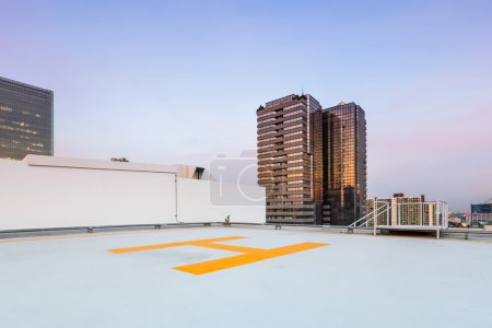 helipad for helicopter on roof top building for people transport