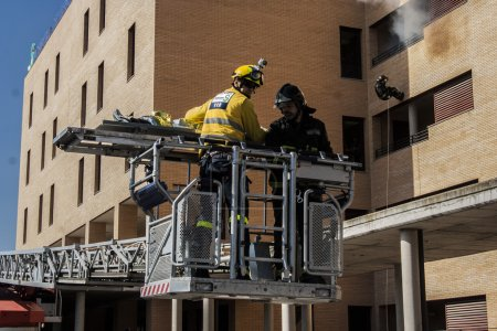 Firefighters working in rescuing injured in a building in Talavera de la Reina, Toledo, Spain